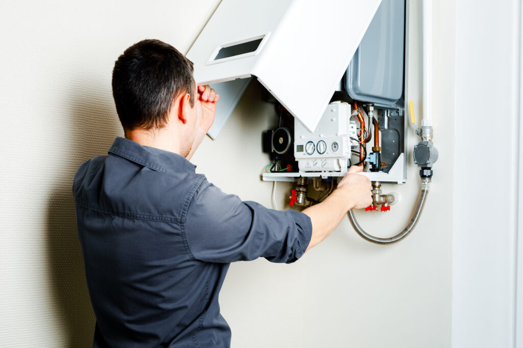engineer fixing a boiler